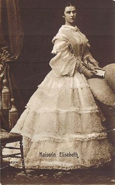 1860 photo of Empress Elisabeth of Austria (1837-1898) wearing a lovely gown of the period.  Elisabeth Amalie Eugenie; Elisabeth of Austria was the wife of Franz Joseph I, and therefore both Empress of Austria and Queen of Hungary. She also held the titles of Queen of Bohemia and Croatia, among others. From an early age, she was called Sisi by family and friends.