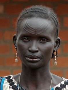 """Africa   Atuot lady, Agany. Al Buhayrat, South Sudan  ©Ngari Norway.  Atuot lady, Agany *Beautiful Tribal Scarification  """"The Atuot consider themselves part of the Dinka group, but seems to have realtions to the Nuer linguistically (from what I have read). The women's group in Agany produce different oils and Lulu cream (Shea butter) from the Lulu nuts that are in abundance in the area."""""""