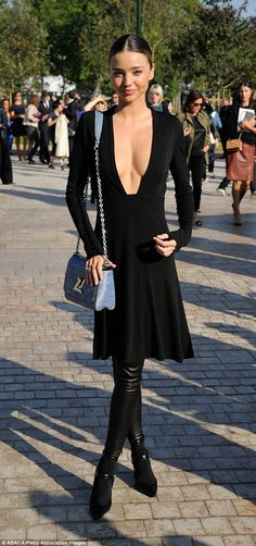 Miranda Kerr arrived at the Louis Vuitton SS15 show wearing a plunging little black dress with a blue tweed bag from the French fashion house http://dailym.ai/1vvJN3K #PFW