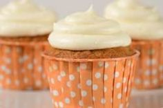 Carrot Cupcakes are moist and flavorful with grated carrots and nuts and are frosted with a delicious cream cheese frosting. From Joyofbaking.com With Demo Video