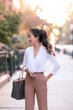 white wrap blouse + tan trouser pants