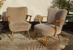 """This pair of armchairs were made in East Germany some time in the 1970s. This style of cocktail chair was first made in the 1950s but I feel that this particular pair were made sometime around 1975. This style of chair """"Bartholomew Cocktail"""" are very fashionable at the moment, chairs from this period like these have become something of a style icon. 