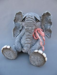Needle felted elephant seated would look great in granitex polymer clay!