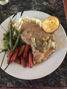 Smoother pork chops, garlic mash potatoes, candied carrots, garlic hand picked green beans and corn muffin