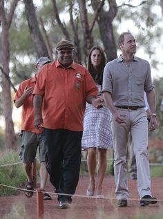 Catherine, Duchess of Cambridge and Prince William, Duke of Cambridge are guided by Sammy Wilson left, along the Kuniya walk at Uluru on April 22, 2014