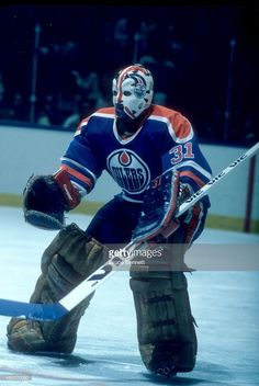 goalie-grant-fuhr-of-the-new-york-islanders-defends-the-net-during-an-picture-id482270060 (685×1024) Hockey Helmet, Hockey Goalie, Hockey Players, Ice Hockey, Goalie Mask, New York Islanders, Edmonton Oilers, Washington Capitals, Nhl