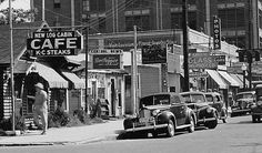 Street scene in downtown Alexandria, Louisiana, early 1940s ... New Log Cabin Cafe, Central News, Modern Cabs, Smith Glass & Mirror, (Kohara) Photos, shoe repair, sandwich shop, and drug store.