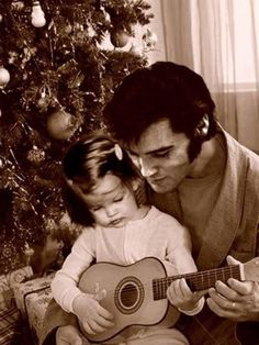 Elvis and his little princess h e adored her. He truly loved his family. He gave Lisa everything because he was poor growing up.. The King lives forever TCB