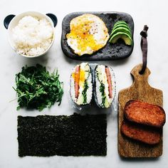 have you guys ever had onigirazu? it's a cross between a free form onigiri   and a sandwich. i stuffed mine with crispy fried spam a lacy fried egg avocado and arugula. SO GOOD! i'm pretending it's a  snack cause i'm heading to maui with @alanakysar @mollyyeh @kaleandcaramel v v soon and i'm so excited!!! recipe with a fun lil gif now on the blog! by iamafoodblog