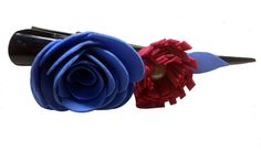 Red-Blue color flower Banana pins (two flowers), made of  imported rubber sheets, beautifully designed and crafted by   village women, giving a new fashion style to hair accessories.   Color: Red and Blue   Material: Imported Rubber sheets  Base material: Imported plastic Banana pin