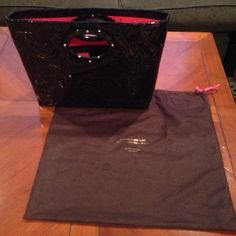 Black Kate spade pattern bag with dust bag Authentic black Kate spade bag , in great condition!! A few ink spots in inside bottom of bag as shown in the pictures! kate spade Bags