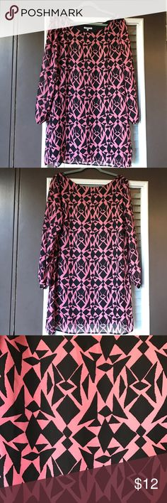EUC pink and black Geo print tunic dress Reposhed due to sizing. Hardly worn and as shown in pics, no pilling or pulls of the 100% polyester. Can be worn as dress or tunic with leggings.has black under shift. One small white spot on fabric as shown in 5th pic but hard to see from usual distance - only found this upon close inspection. Pink is not bright but almost coral. Priced based on this tiny flaw. Charlotte Russe Dresses Mini