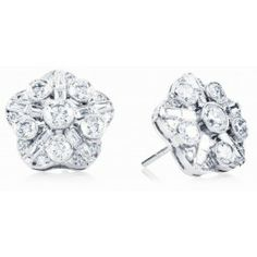 These diamond ''Art Deco'' style button earrings from Birks revival, crafted in 18 kt white gold with post and butterfly closure is set with 52 rectangular baguette cut diamonds and round brilliant cut diamonds with an approximate total weight of 2,08 carats, clarity VS-SI, colour HIJ. #BlueBox via @Maison Birks