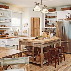 A mixture of hard and soft woods can transform a blah kitchen into a warm gathering space.