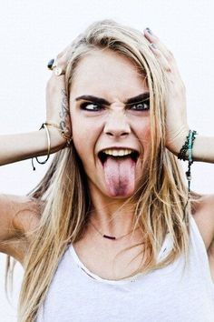 Cara Delevingne shot by photographer Kate Simon Harris for her upcoming movie 'Kids in Love': Word around town, Drake had the hotline blinging. Cara Delevingne, Kendall Jenner, Girl Tongue, Kids In Love, Shooting Photo, Face Expressions, Poses, Woman Crush, Mannequins