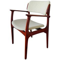 Eric Buck Rosewood Arm Chair | From a unique collection of antique and modern armchairs at https://www.1stdibs.com/furniture/seating/armchairs/