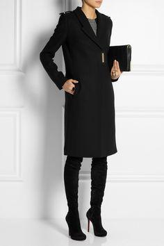 Victoria BeckhamWool coat, Jason Wu dress, Marni ring, Chloé ring, Christian Louboutin boots, 3.1 Phillip Lim clutch.
