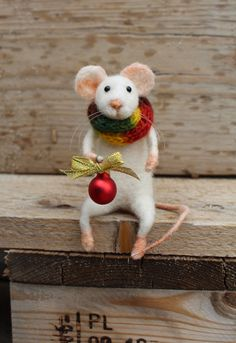 Needle felted christmas mouse, Christmas mouse, Felted mouse, Christmas decoration, Felted white mouse with christmas red ball, Gift idea by misha2smile on Etsy https://www.etsy.com/ca/listing/489639433/needle-felted-christmas-mouse-christmas