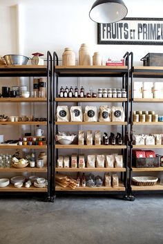 Could make something on wheels - bottom half chalkboard front? Top half backed w black wall for shelves? Also - those beige baggies with the circle logo are rad