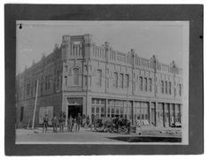 Historic building on the corner of the Denton Square which includes the Wright Opera House and Parlin and Orendorff, ca.1900, now Recycled Books.