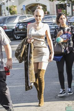 Golden girl! Heads were turning when Kylie Jenner stepped out in her second outfit of her ...