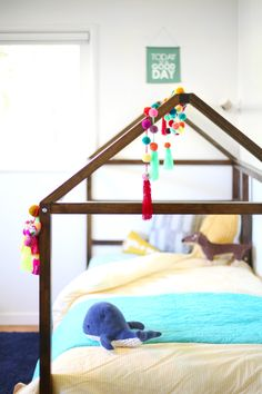 DIY IKEA Kura bed hack - add a roof onto your toddler's bed.