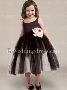 Cute flower girl dress features in tulle over satin. Tiered skirt with detachable flower accent.