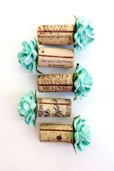 Wedding Place Card Holder Ideas - beautiful handmade Aqua blooms on vintage wine corks.  These make for a stunning Place Card Table!