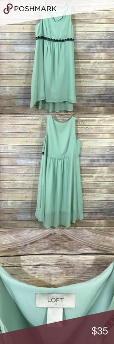 """Loft mint green hi-low dress size 12, 104 This pretty mint green dress from Loft is a perfect summer staple! It has black Embroidered detail and has a slight hi-low hemline.  It is a size 12 and measures 19""""flat across the bust and 18"""" flat across the waist and it is 37"""" long at the shortest hem to 42"""" at the longest part.  It is in excellent preowned condition with no known flaws, I wore this once and washed. LOFT Dresses High Low"""