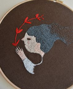 Melodie Stacey - An original embroidery hand stitched by me..  based on my own illustrations, a portrait of an imaginary girl  sewn onto Irish linen...  size of