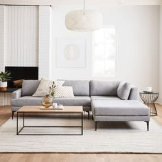 Inspired by paper lanterns, our height-adjustable Open Weave Pendant is made by wrapping paper string around a frame for a light and airy look. Living Room Wood Floor, Living Room Grey, Home Living Room, Apartment Living, Apartment Couch, Grey Couch Rooms, Grey Couch Decor, Grey Couches, Living Room Images