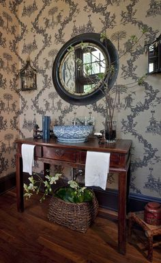 The vanity is an antique Chinese altar table, the sconces were electrified and mirrored, the basket is very old and Japanese, and the sink is a blue and white porcelain beauty from Linkasink.