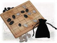Yoté is an exciting draughts-like game from West Africa. Pieces are dropped onto the board wherever and whenever the players choose, and move to adjacent squares in any of the four cardinal directions. Capture is by the leap as in draughts, but each time you capture a piece, you may take a second piece from anywhere on the board!