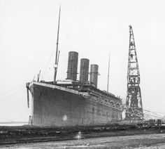 Titanic at the fitters quay with the three working funnels installed.  The fourth funnel was a dummy intended to make the ship look more impressive and safer to the public.  Also, since Cunard's newest ships, Mauretania and Lusitania, had four funnels it was thought that White Star ships should not have less.