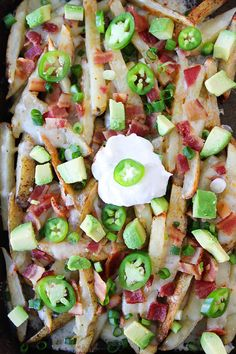 Loaded Cheese Fries Recipe. Baked fries that are loaded with cheese, bacon, avocado, jalapeño, and sour cream! Perfect for game day or any day!