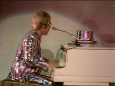 Elton John -  Crocodile rock  Summer of '72--riding home from work. Summer nights.