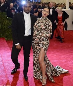 Its a match: Kim Kardashian, who has preciously been banned from the event, wore a floral dress with matching gloves and shoes as she posed up with boyfriend Kanye West
