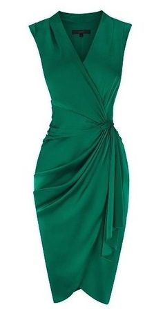 Stunning emerald colour and a flattering cut on almost all women! The wrap-look highlights the waist and draping hides the common 'problem bits'. LOVE IT!