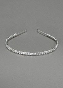 Add just the right amount of sparkle with this stunning headband.  Thin headband is completely encrusted with rhinestone detail.  Available in Silver.  Imported.