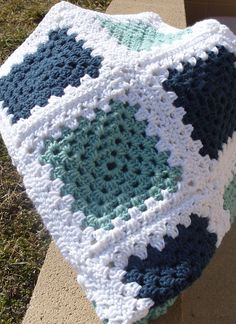 Crochet Afghan Blue Green and White Granny Square / Granny Square Afghan / Handmade Blanket / Granny Square Blanket  ☼☼☼☼☼☼☼☼☼☼ READY TO SHIP ☼☼☼☼☼☼☼☼☼☼  This Granny square afghan measures 33 X 39. It is made of sage green, navy blue with white borders.  Great size to cover up your legs. Machine wash low heat, air dry. Thank you for looking at our afghans if you see one you like but would like different colors please let us know.