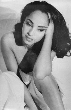 Sade, there is absolutely no one like her! PHENOMENAL singer, songwriter, performer, fashionista, etc...<3<3<3<3.