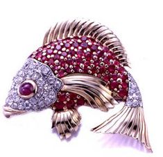 Seaman Schepps fish, circa 1950. Rubies, diamonds, and gold.