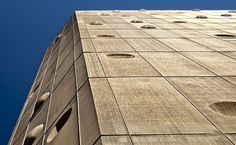 The aerodynamic shape was designed to deflect wind gusts, which move fluidly around the façade | Golden Screened Indra Office Tower Enlivens Barcelona's Poblenou | #SustainableDesign #Innovation #Eco #Architecture #Green #Building
