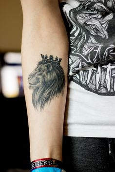 Lion with a crown tattoo on the arm/elbow | In2Ink, Congleton, Cheshire, England, United Kingdom.