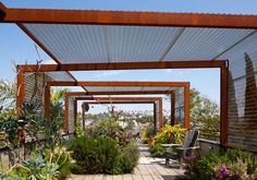 A rooftop garden uses steel armatures with perforated metal panels to provide relief from the sun. canopies