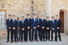 navy suit wedding party - all the guys in different shades of navy