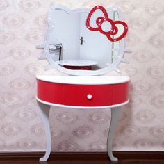 Any little girl would love this to play dress up and put her make up on.  Adorable Hello Kitty vanity/make up vanity.