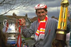 Kenny Dalglish celebrates winning the Double in his first season as manager