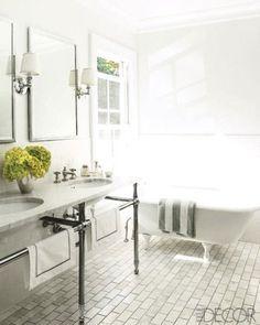 bathroom, elle decor, bath, freestanding tub, pedestal sink, carrera marble, subway tile, stripe towel, white bathroom, sconces with shade, hand towel
