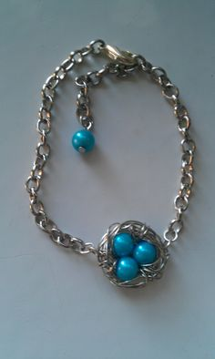 Wire wrapped birds nest bracelet by gingerbreadstudios on Etsy, $18.00